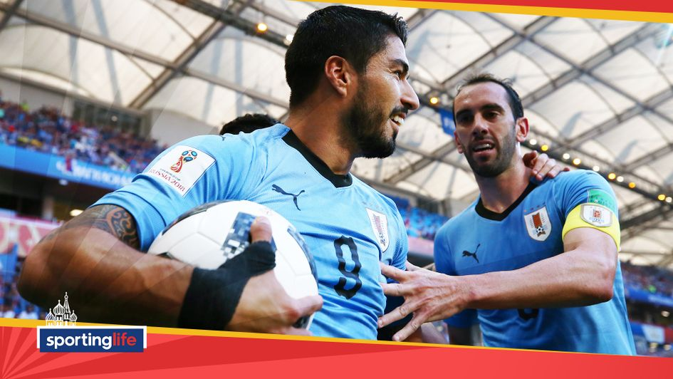 Luis Suarez celebrates scoring Uruguay's first goal against Saudi Arabia