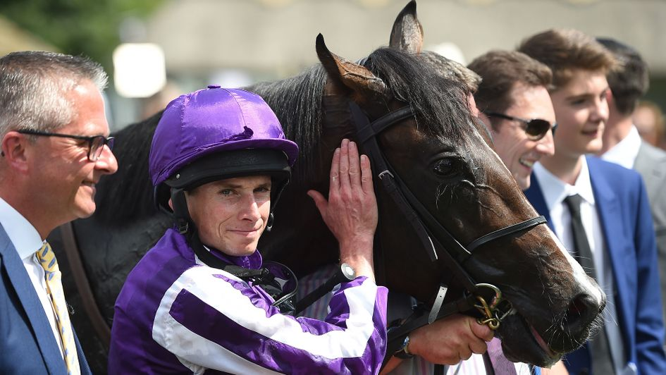 Ryan Moore and U S Navy Flag pose for a photograph