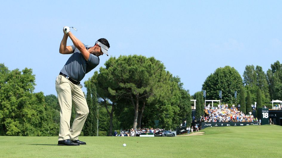 Lee Slattery plays his approach to the 18 holes