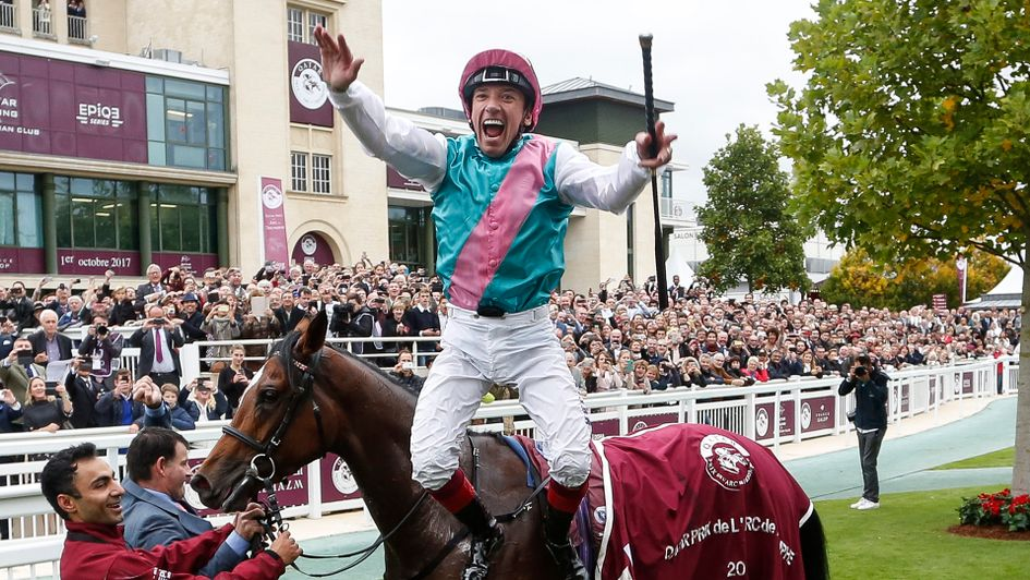 Frankie Dettori performs a flying dismount from Enable after winning the Arc