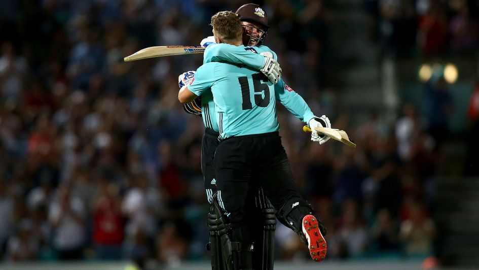Jason Roy and Aaron Finch celebrate