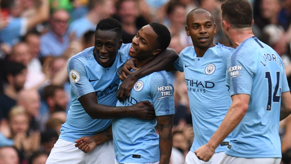 Raheem Sterling is congratulated after scoring