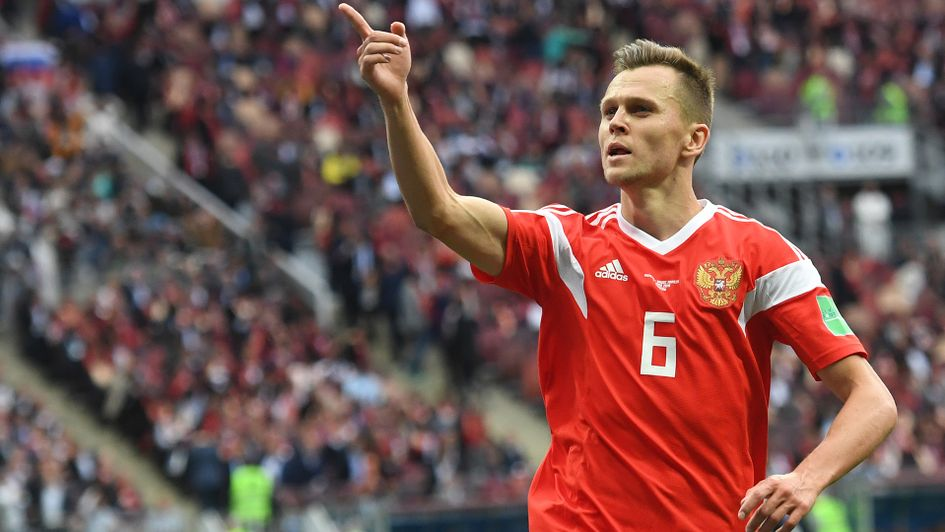 Denis Cheryshev: The Russia winger celebrates after scoring his second goal of the game v Saudi Arabia in the World Cup