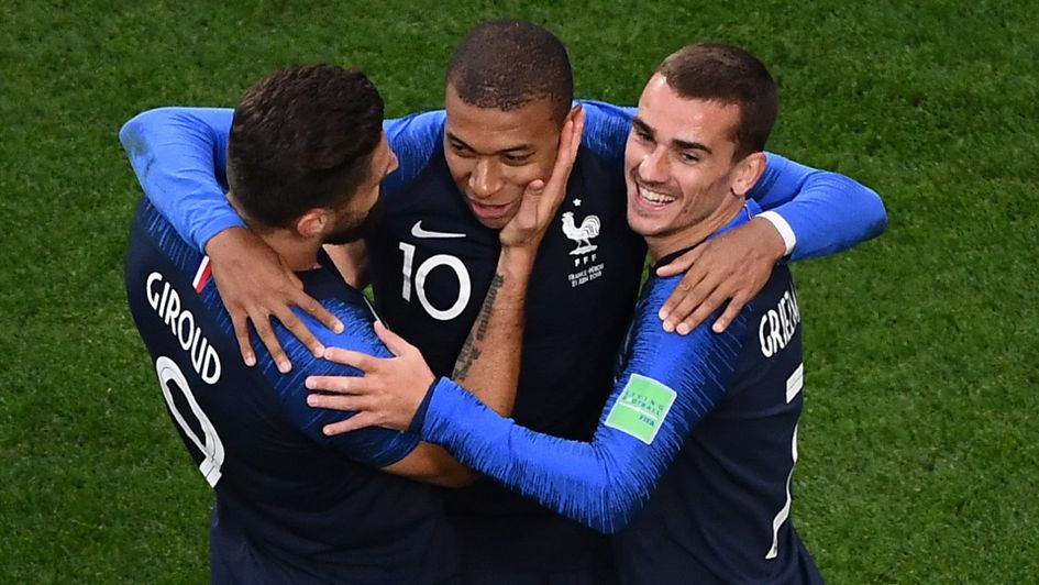 Olivier Giroud (left) and Antoine Griezmann (right) celebrate Kylian Mbappe's goal for France at the World Cup