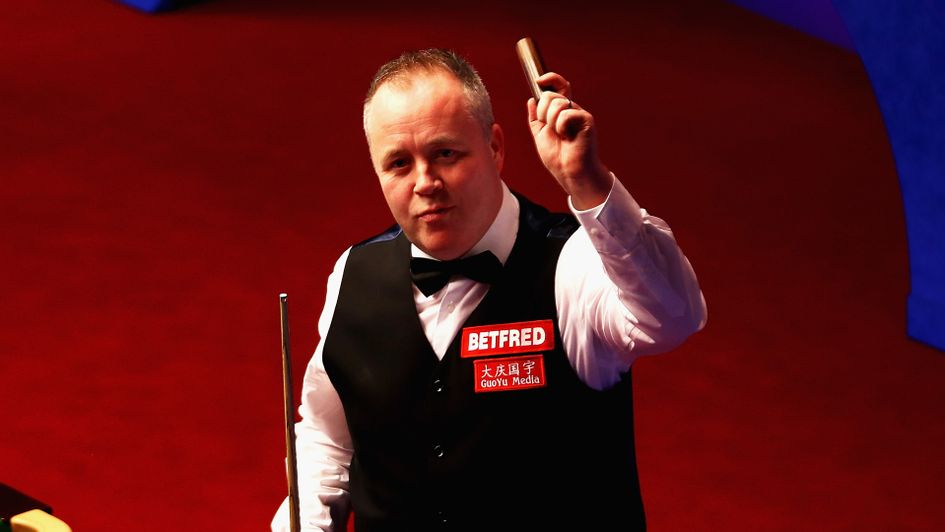 John Higgins celebrates his win