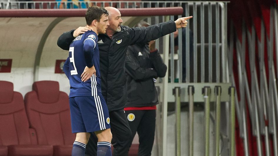 Scotland boss Steve Clarke (right) gives instructions to captain Andrew Robertson
