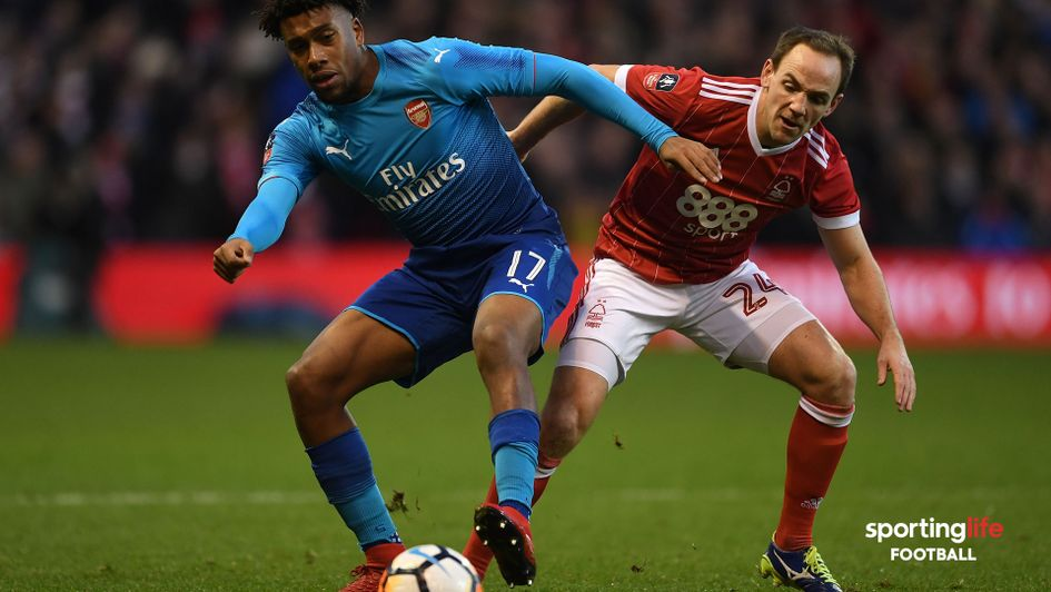 David Vaughan (right) in action against Arsenal