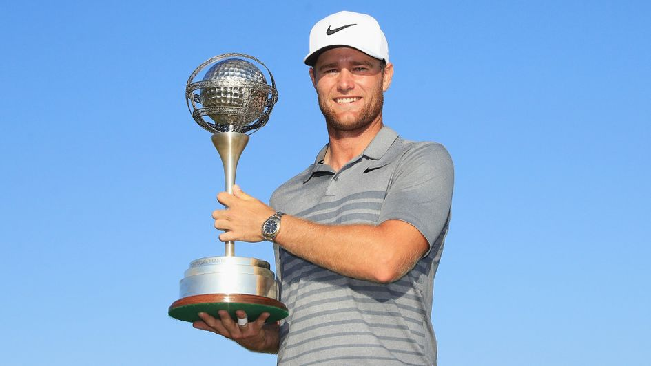 Lucas Bjerregaard celebrates with the trophy for the Portugal Masters