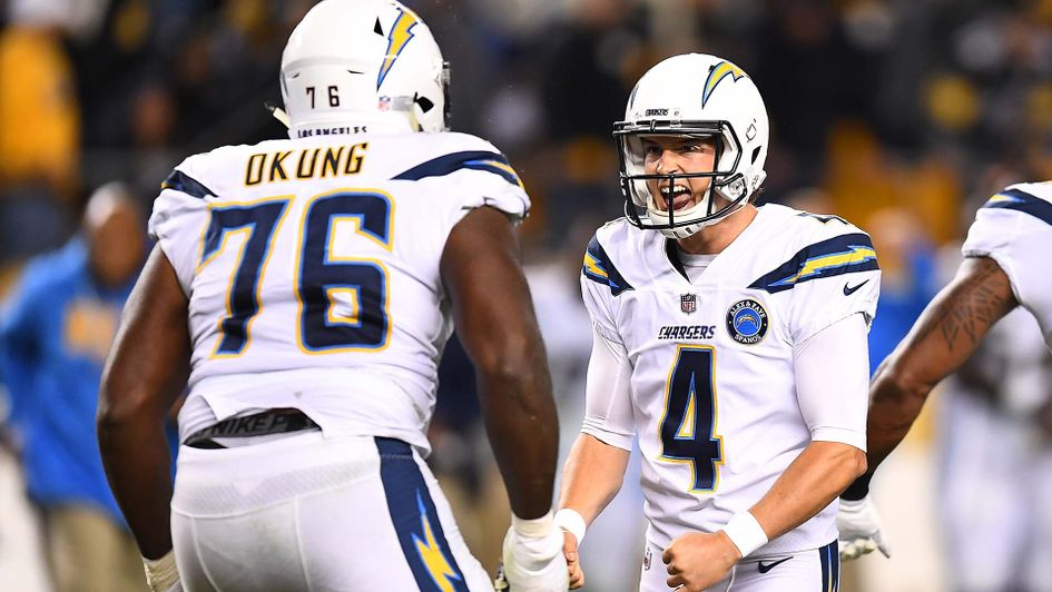 Mike Badgley of the LA Chargers celebrates after making a winning field goal