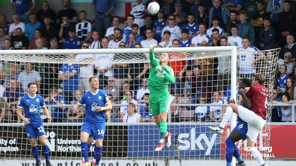 Tranmere goalkeeper Scott Davies punches the ball clear