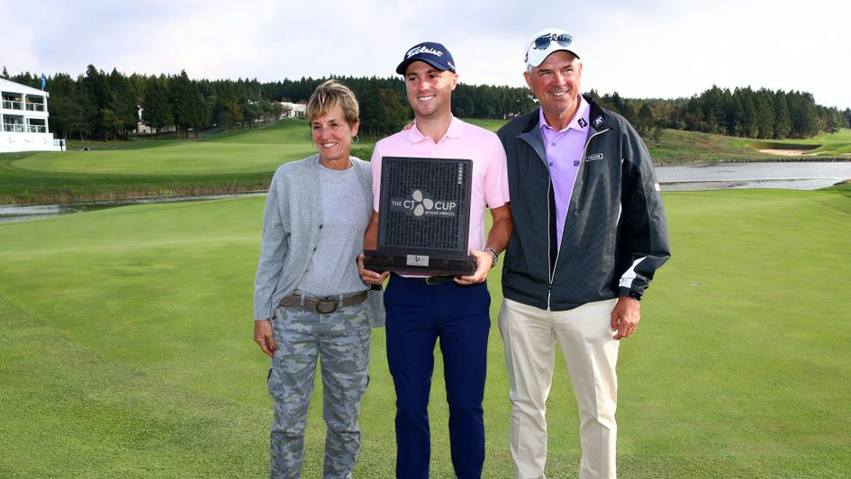 Justin Thomas of the United States poses with his mother Jani and father Mike