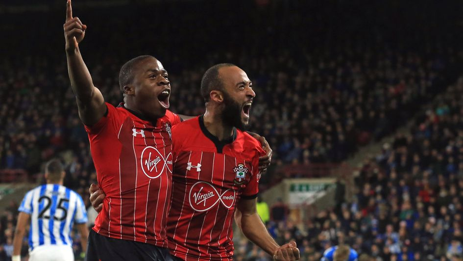 Michael Obafemi (left) celebrates with Southampton team-mate Nathan Redmond at Huddersfield