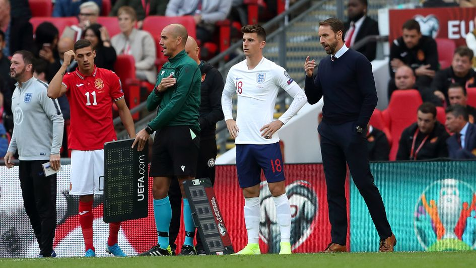 Mason Mount receives instructions from Gareth Southgate
