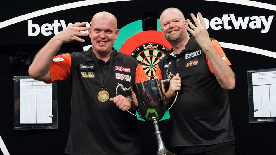 Raymond van Barneveld and Michael van Gerwen hold the World Cup of Darts trophy (Picture: Kelly Deckers/PDC)