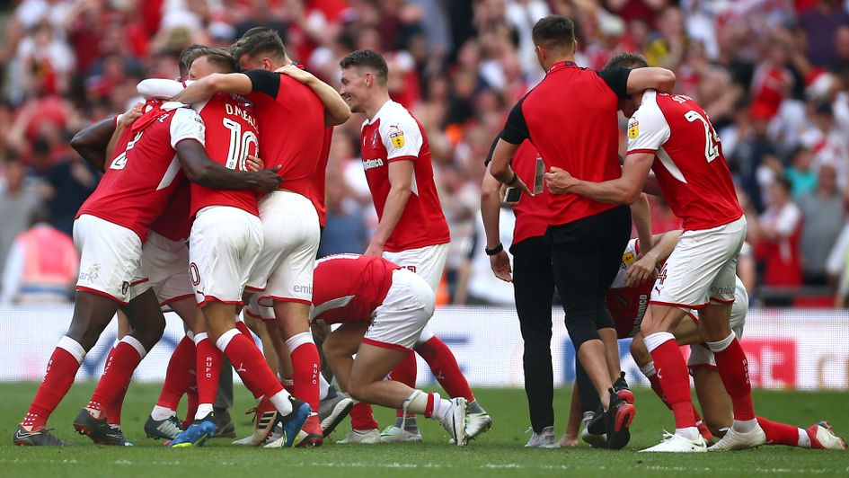 Rotherham players celebrate achieving promotion to the Sky Bet Championship