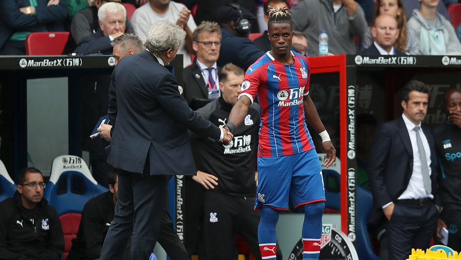 Roy Hodgson shakes hands with Wilfried Zaha before the Crystal Palace forward's cameo against Everton
