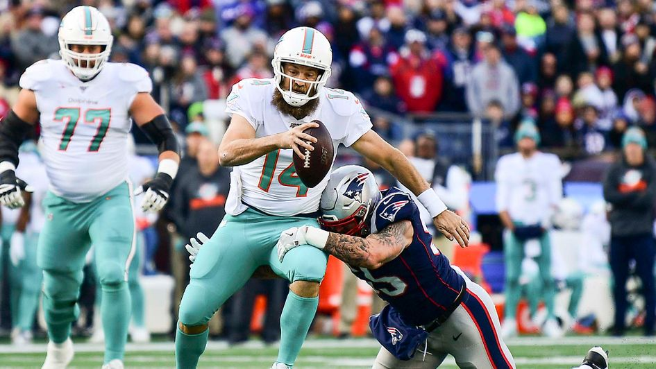 Ryan Fitzpatrick of the Miami Dolphins playing against the New England Patriots