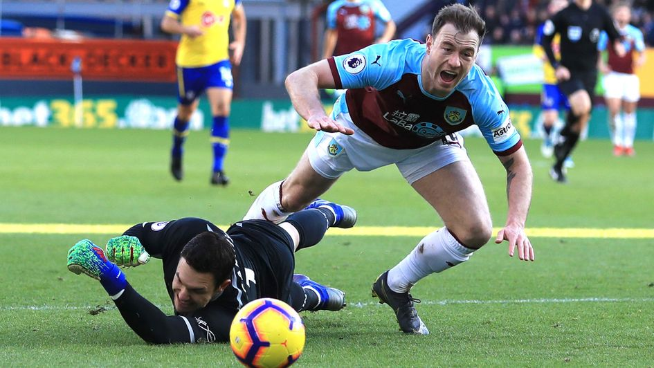 Penalty or not? Ashley Barnes is booked for this, rather than being given a penalty