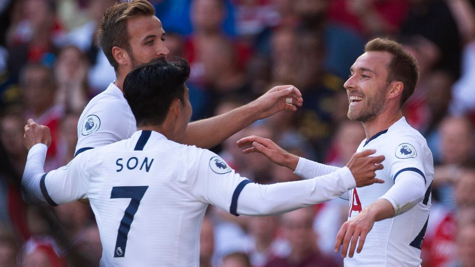 Tottenham celebrate Christian Eriksen's (right) goal in the north London derby at Arsenal
