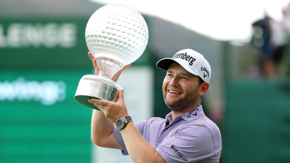Branden Grace with the Nedbank Golf Challenge trophy
