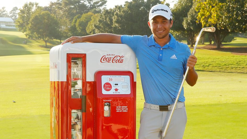 Xander Schauffele celebrates with the Calamity Jane trophy
