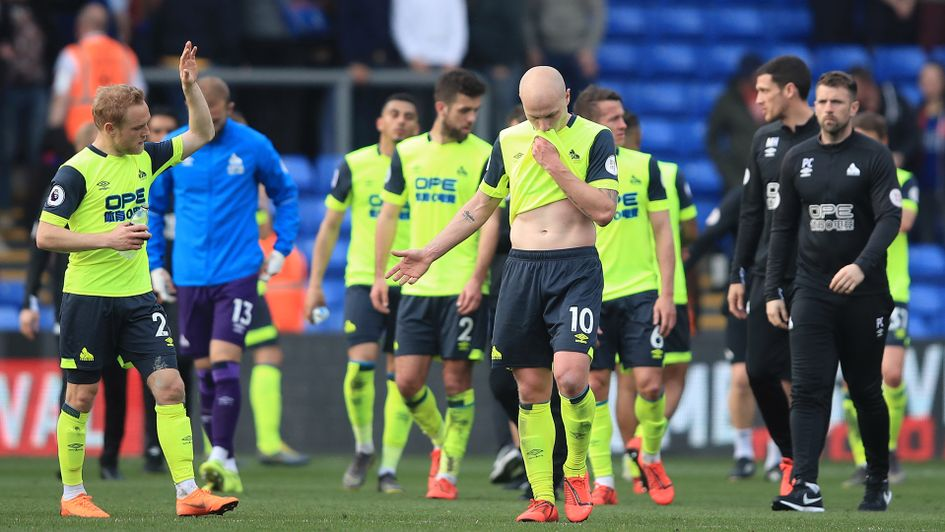Huddersfield players react after being relegated