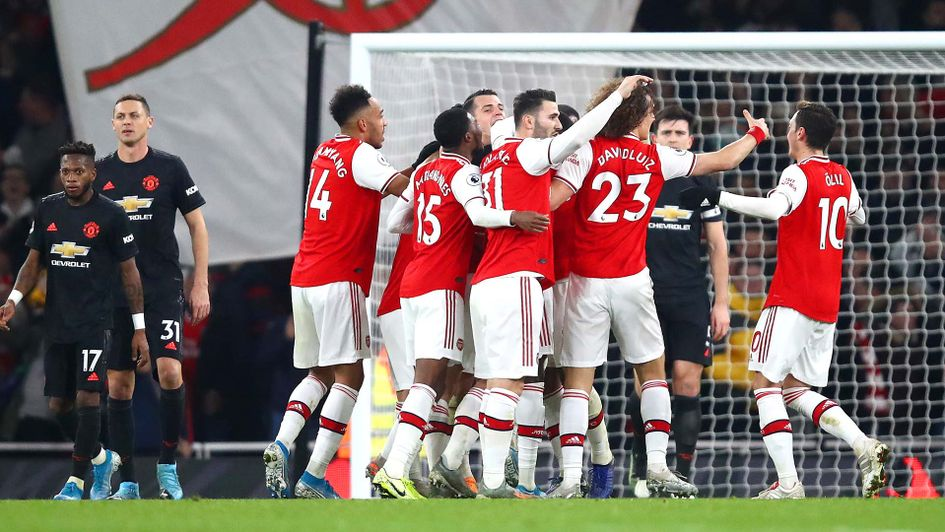 Arsenal celebrate scoring against Manchester United at the Emirates