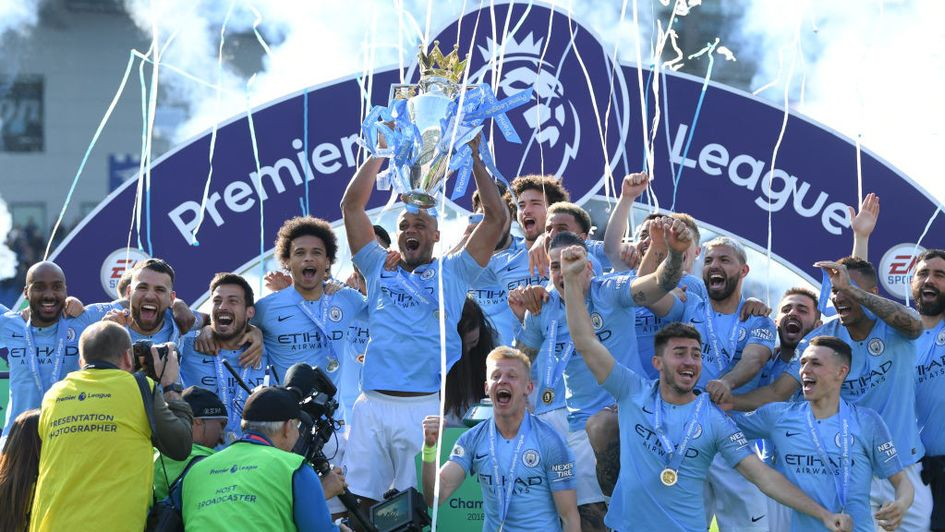 Vincent Kompany and Manchester City lift the 2018/19 Premier League trophy