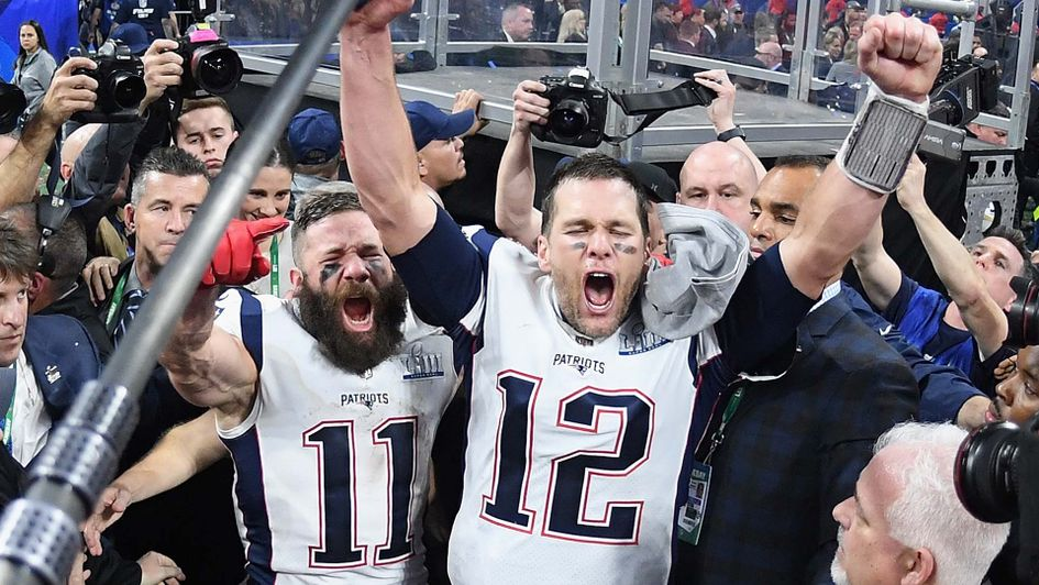 Tom Brady and Julian Edelman celebrate winning the Super Bowl