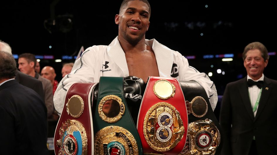 Anthony Joshua with his growing collection of belts