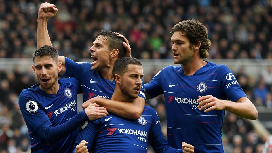Chelsea players celebrate Eden Hazard's penalty at Newcastle