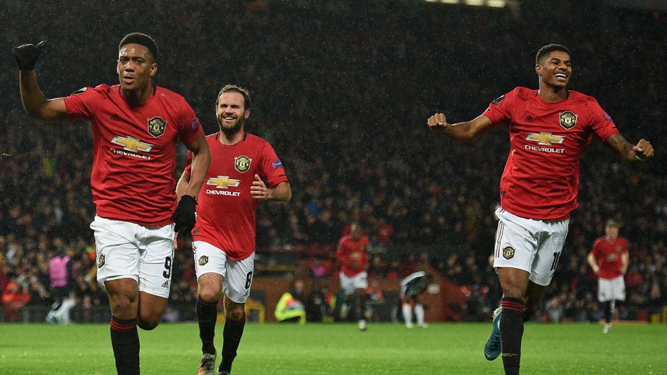 Anthony Martial and Marcus Rashford celebrate Manchester United beating Partizan Belgrade