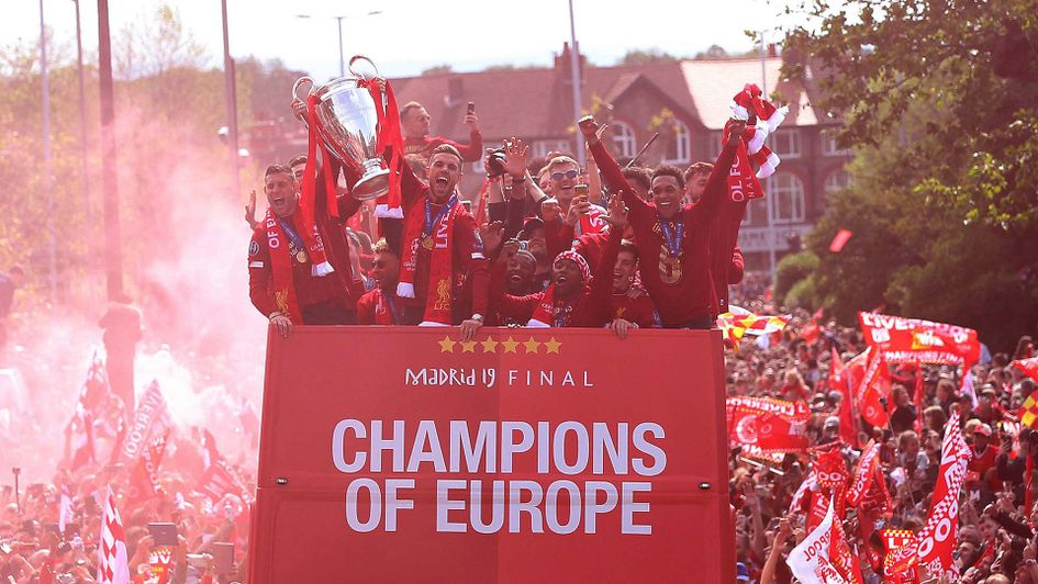 Liverpool celebrate their Champions League win with a trophy parade around the city