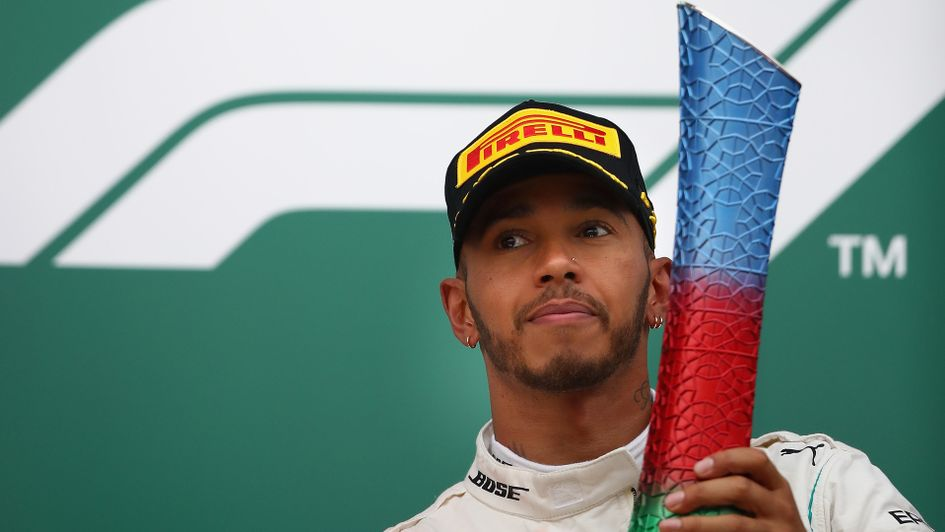 Lewis Hamilton with his trophy after winning the Azerbaijan Grand Prix