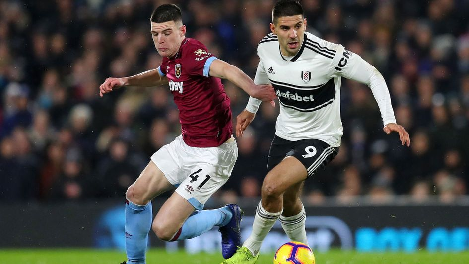 Aleksandar Mitrovic of Fulham is challenged by Declan Rice of West Ham United