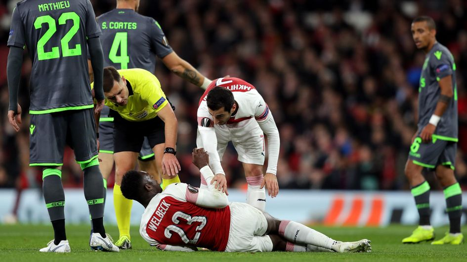 Danny Welbeck is injured in Arsenal's draw with Sporting Lisbon