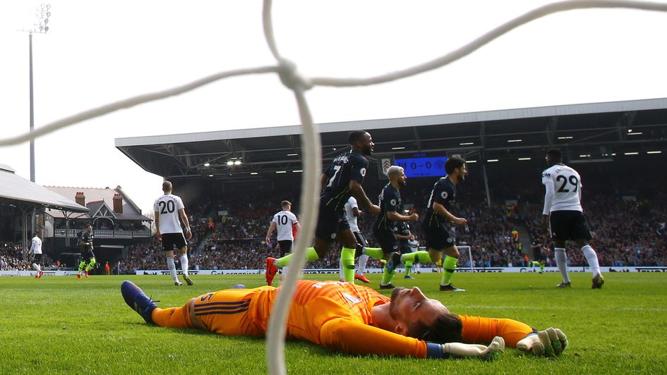 Fulham's Sergio Rico reacts after conceding against Manchester City