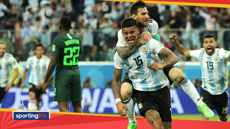 Marcos Rojo celebrates his winning goal for Argentina with Lionel Messi