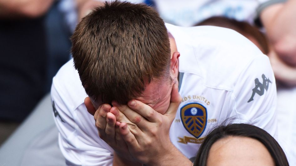 The reaction says it all, as a Leeds fan reacts to Derby's late equaliser