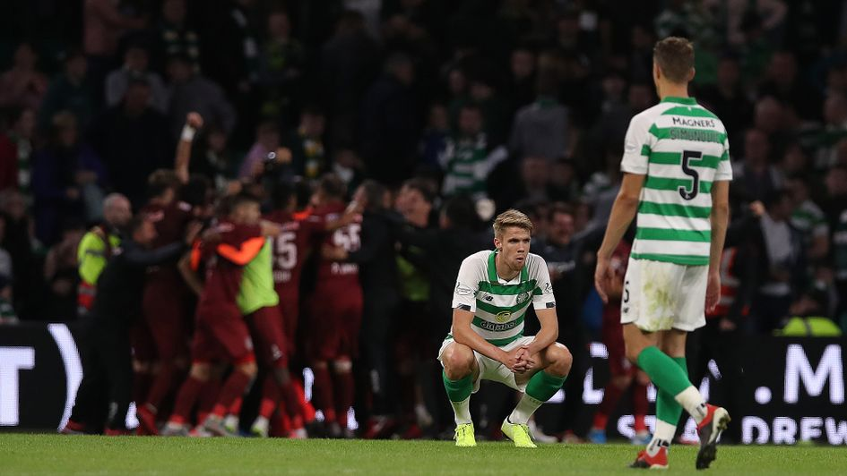 Kristoffer Ajer looks on as Cluj celebrate