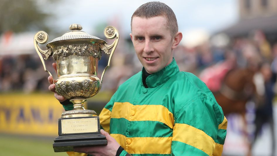 Mark Walsh poses with the trophy after Unowhatimeanharry's win