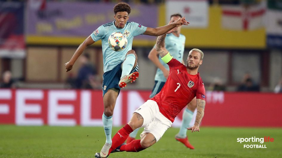 Austria's Marko Arnautovic (right) and Northern Ireland's Jamal Lewis battle for the ball