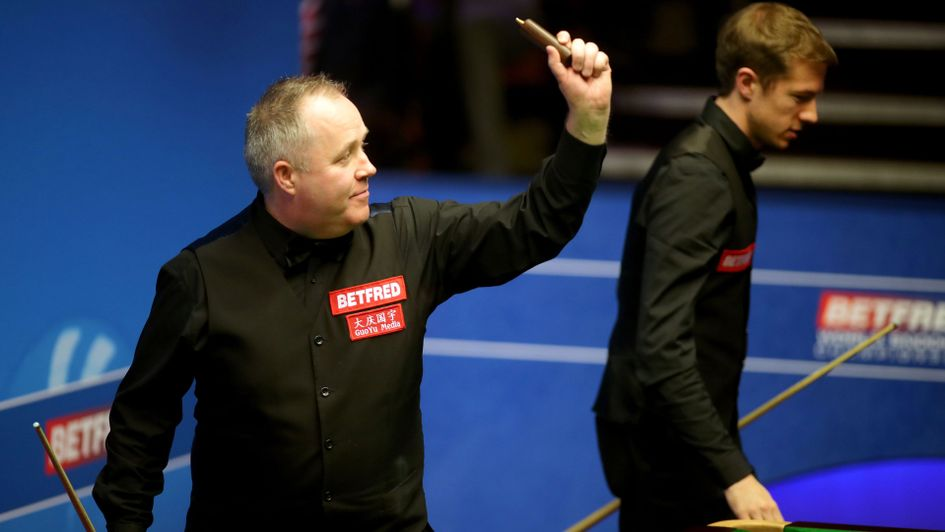 John Higgins celebrates after beating Jack Lisowski