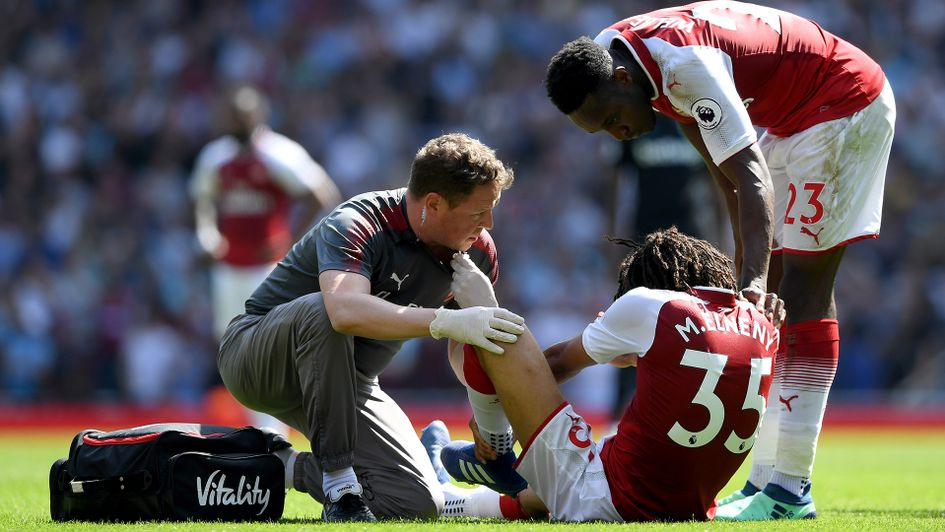 Mohamed Elneny receives treatment during West Ham game