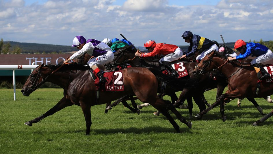 Breton Rock sweeps past the field in the Qatar Lennox Stakes
