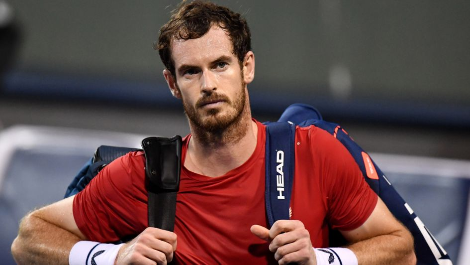 Andy Murray: The British ace leaves the court after losing to Fabio Fognini at the Shanghai Masters