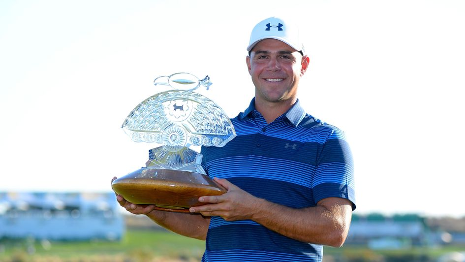 Gary Woodland with the Waste Management Phoenix Open trophy