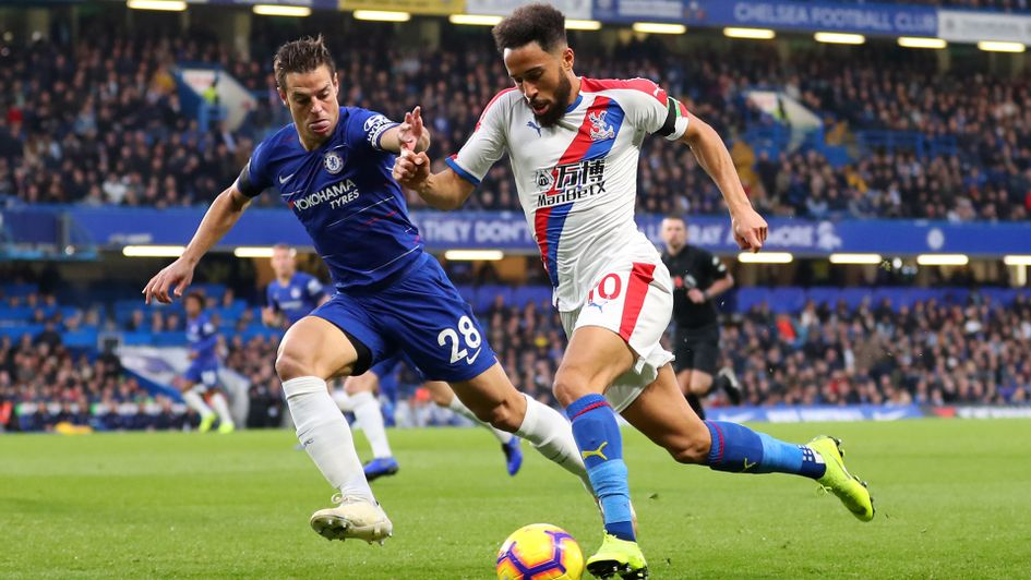 Andros Townsend (right) is challenged by Cesar Azpilicueta