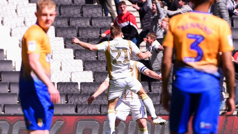 David Wheeler celebrates putting MK Dons 1-0 against promotion rivals Mansfield
