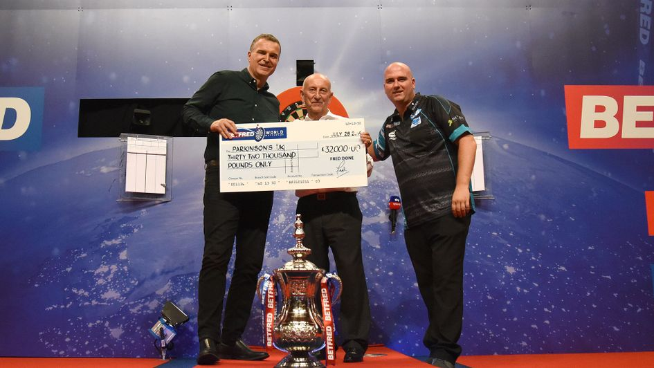 Betfred's Fred Done with Sky Sports' Dave Clark and World Matchplay champion Rob Cross (Picture: Chris Dean/PDC)